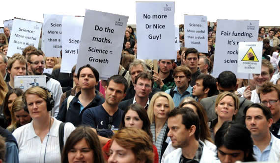 Science is vital demostrators with placards