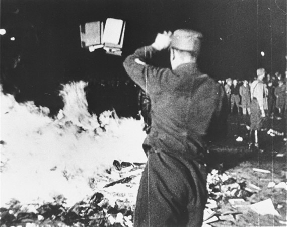 Welcome: A member of the SA throws confiscated books into the bonfire